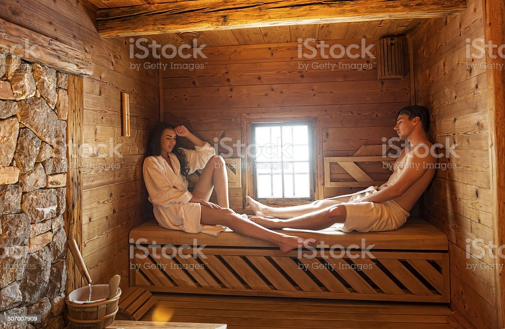 Young couple in sauna stock photo