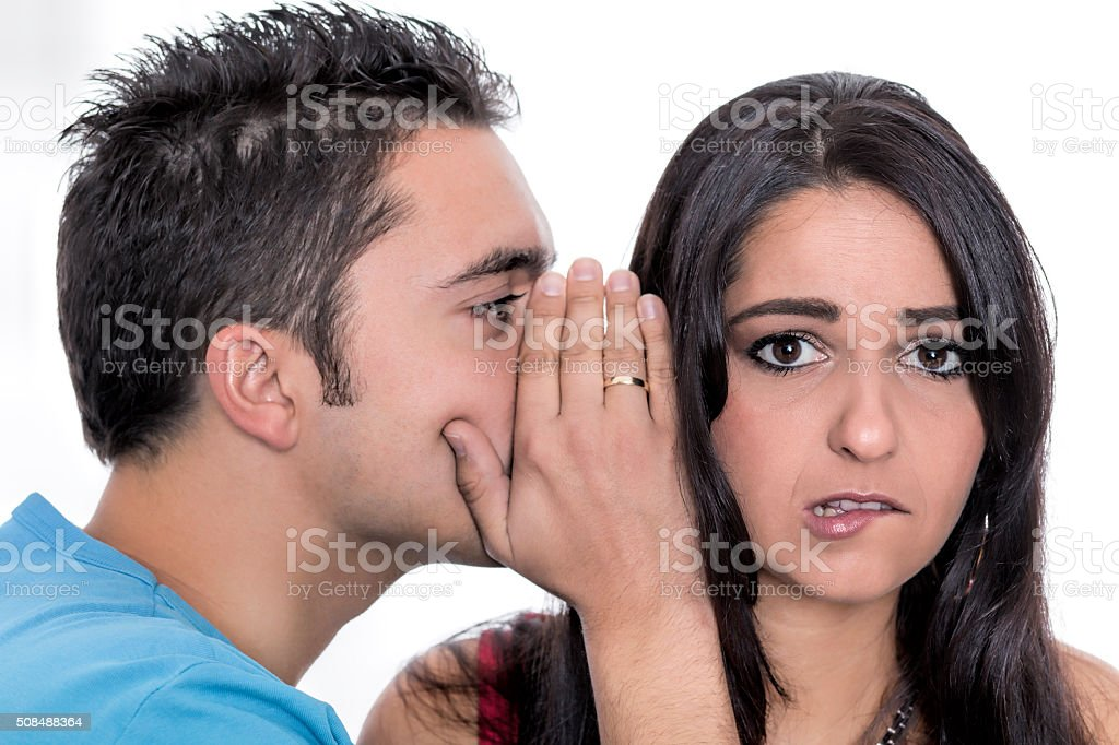 Young couple in secret communication stock photo