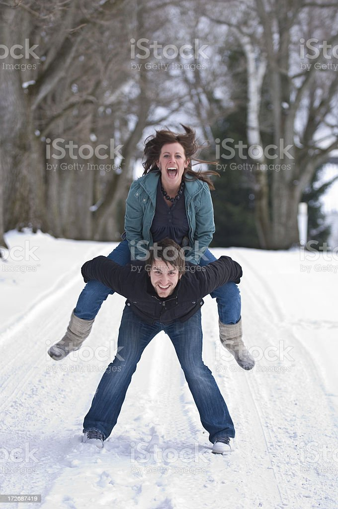 Young Couple in Snow royalty-free stock photo