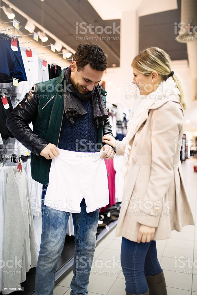 Young couple in store buying  men's underwear stock photo