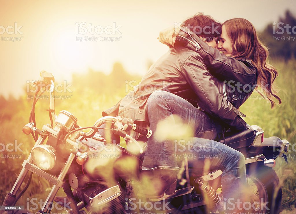 Young couple in sunset stock photo
