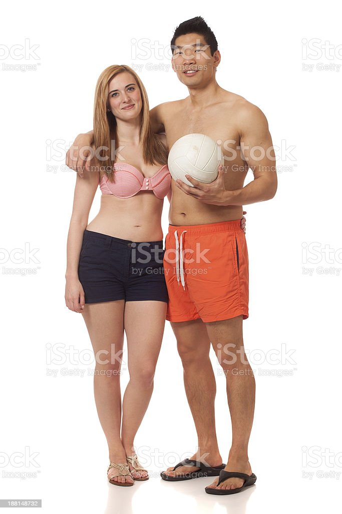 Young Couple in Swimwear with Volleyball royalty-free stock photo