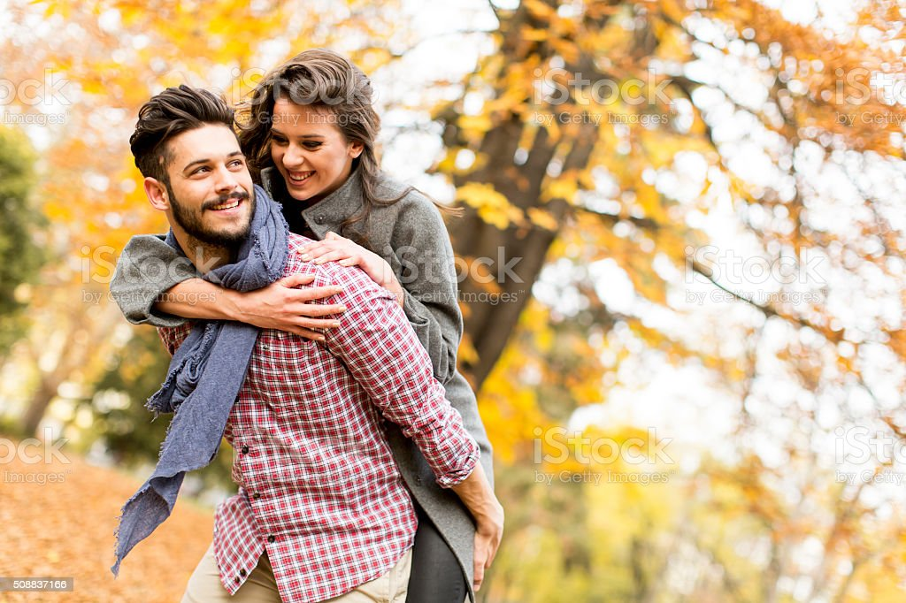 Young couple in the autumn forest stock photo