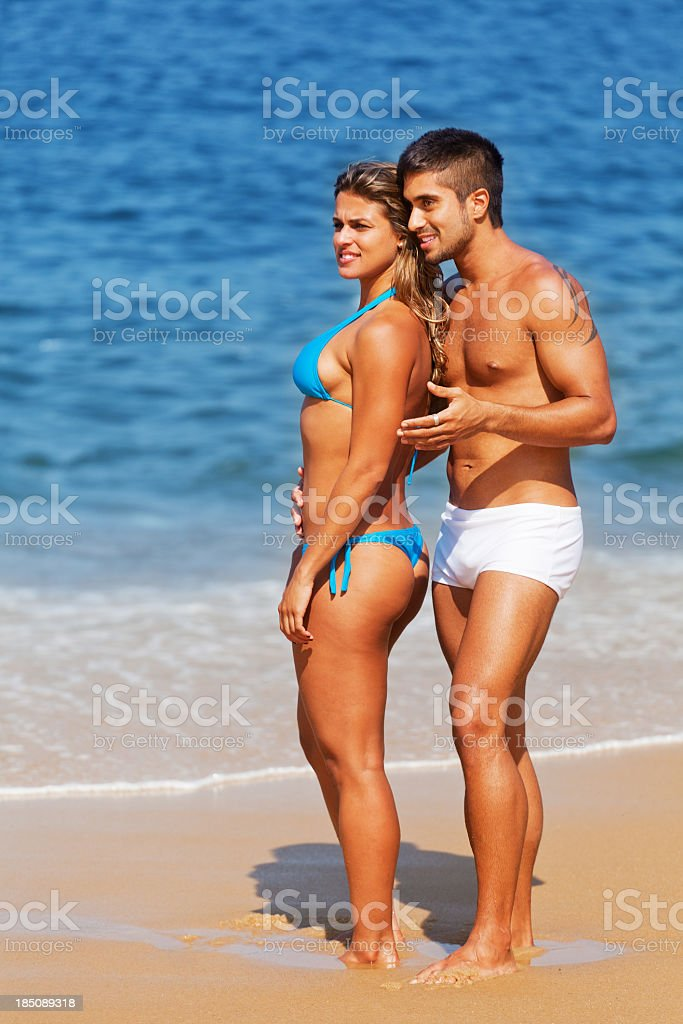 Young couple in the beach royalty-free stock photo