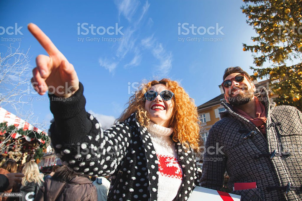 Young couple in the city during christmas stock photo
