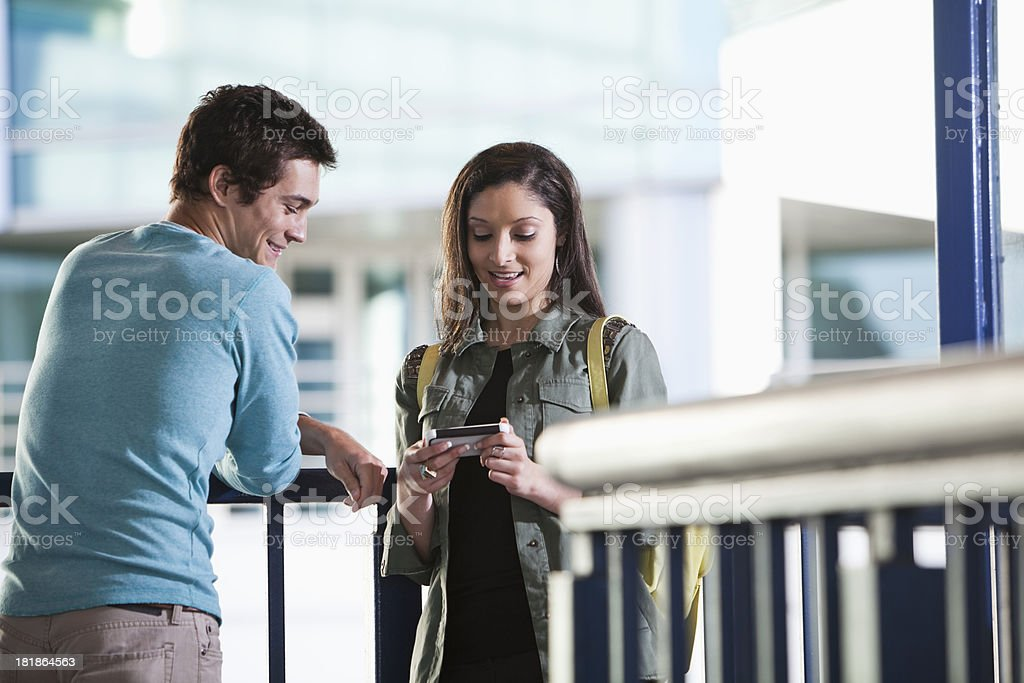 Young couple in the city texting stock photo