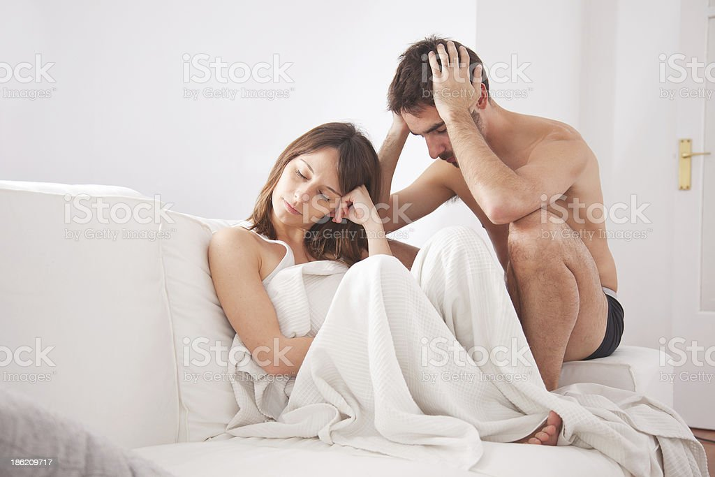 Young couple in the couch having conflict problem stock photo