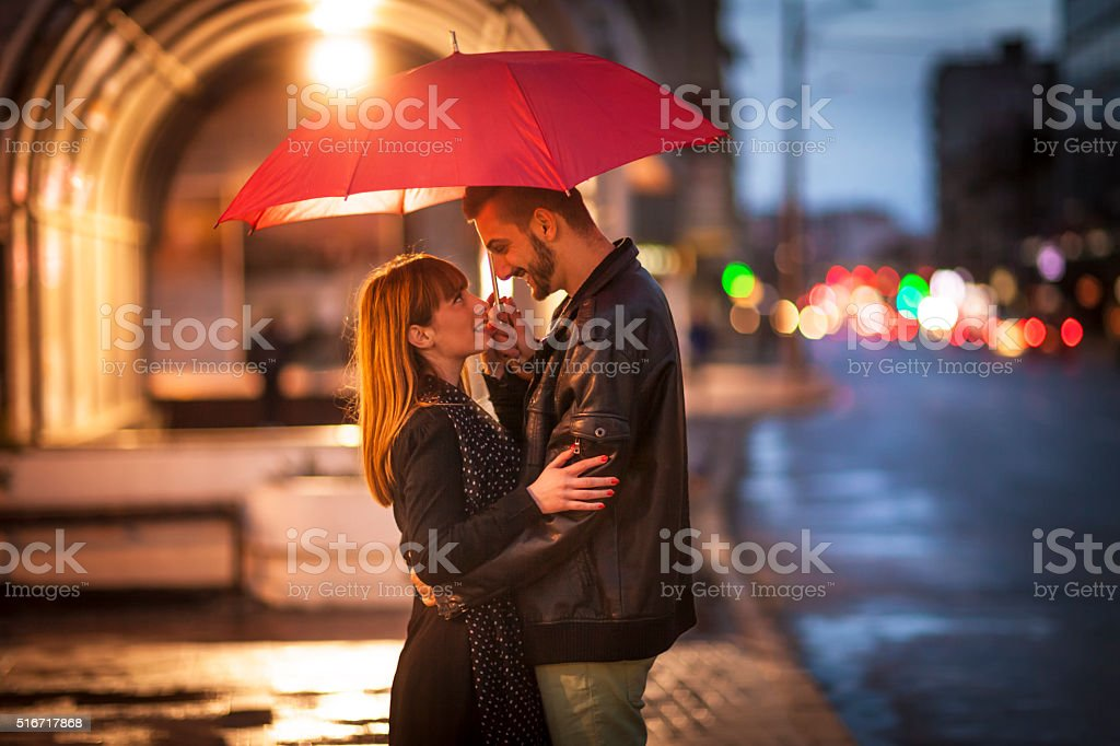 Young couple in the rain stock photo