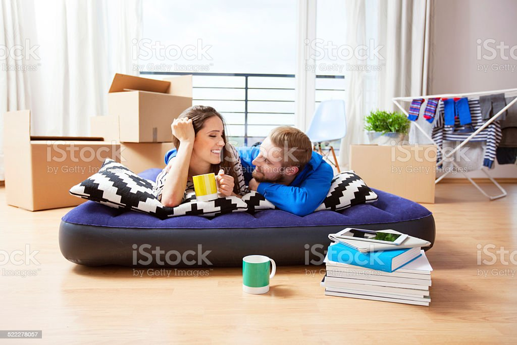 Young couple in their new apartment stock photo