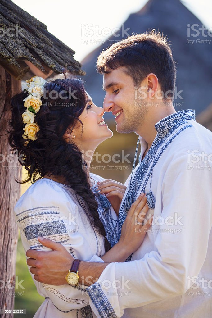 Young couple in Ukrainian style clothes outdoors stock photo