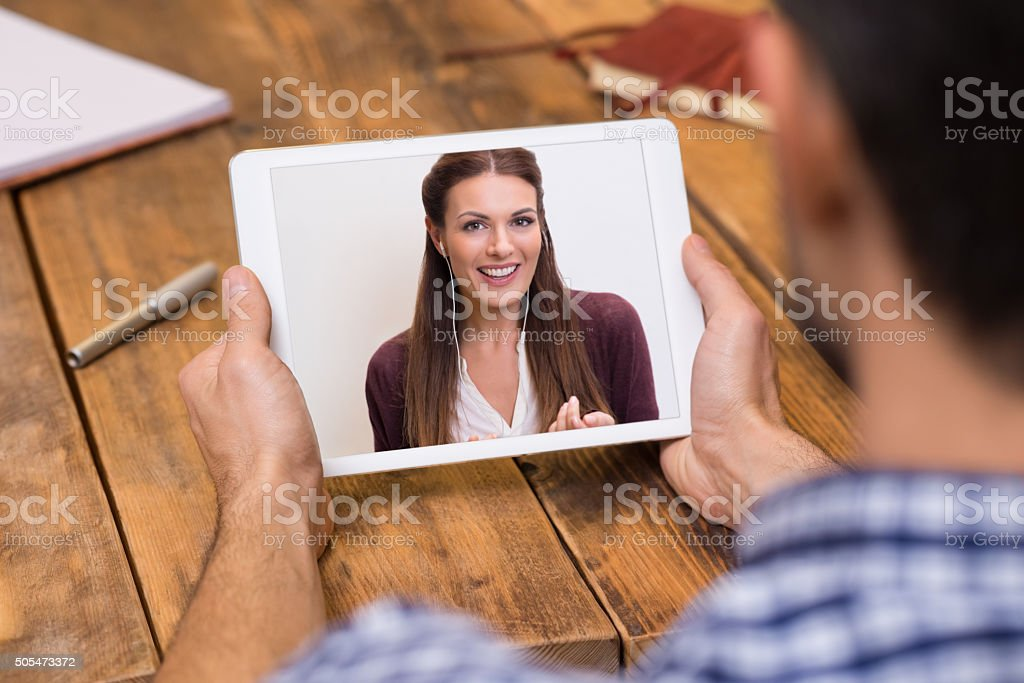 Young couple in video chat stock photo