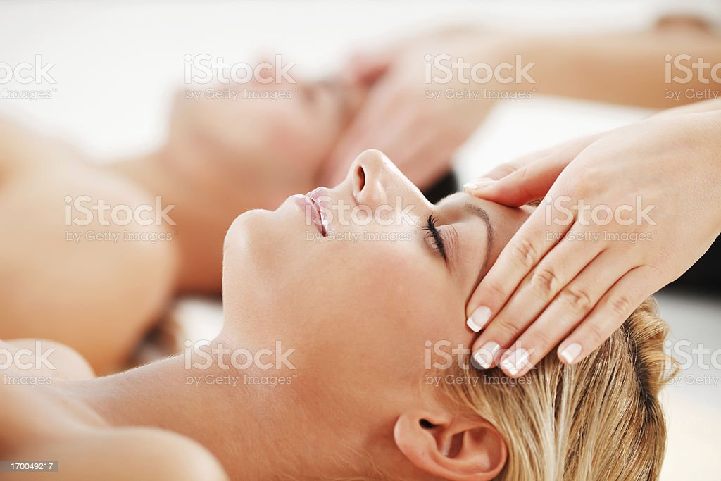 Young couple is having a head massage at spa centre. royalty-free stock photo