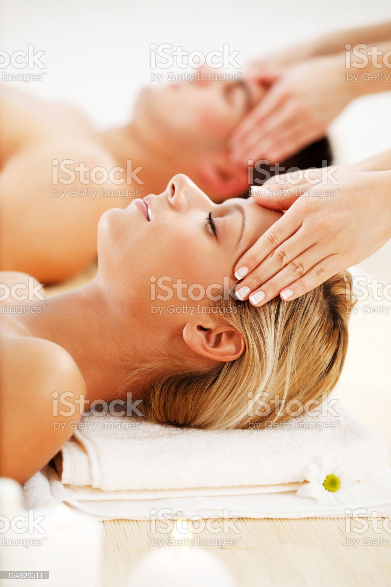 Young couple is having a head massage in spa center. royalty-free stock photo