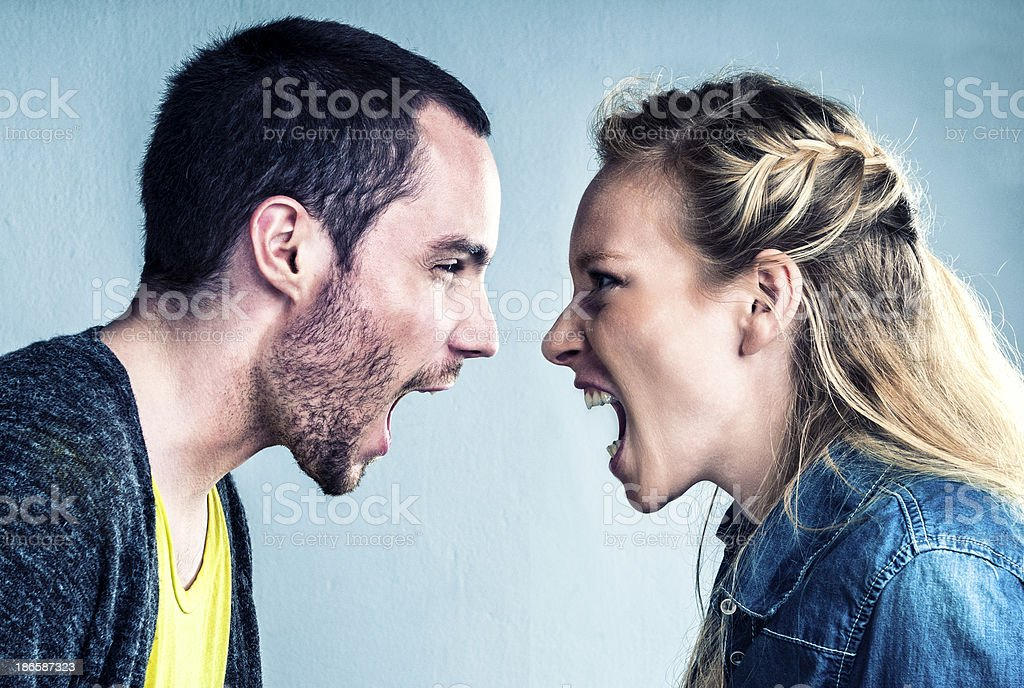 Young couple is in the middle of a big discussion stock photo