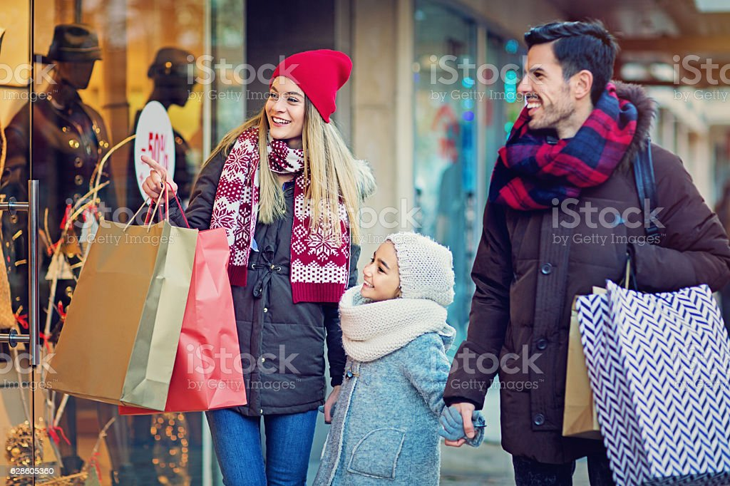 Young couple is looking in the shop window at Xmas stock photo