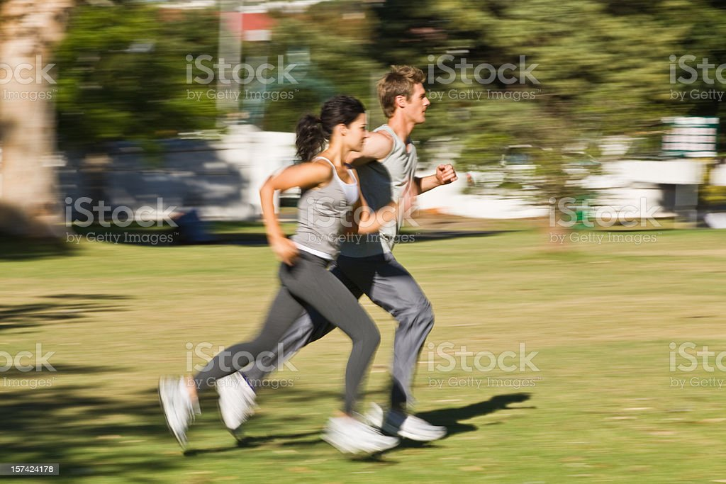 Young Couple jogging at the park together royalty-free stock photo