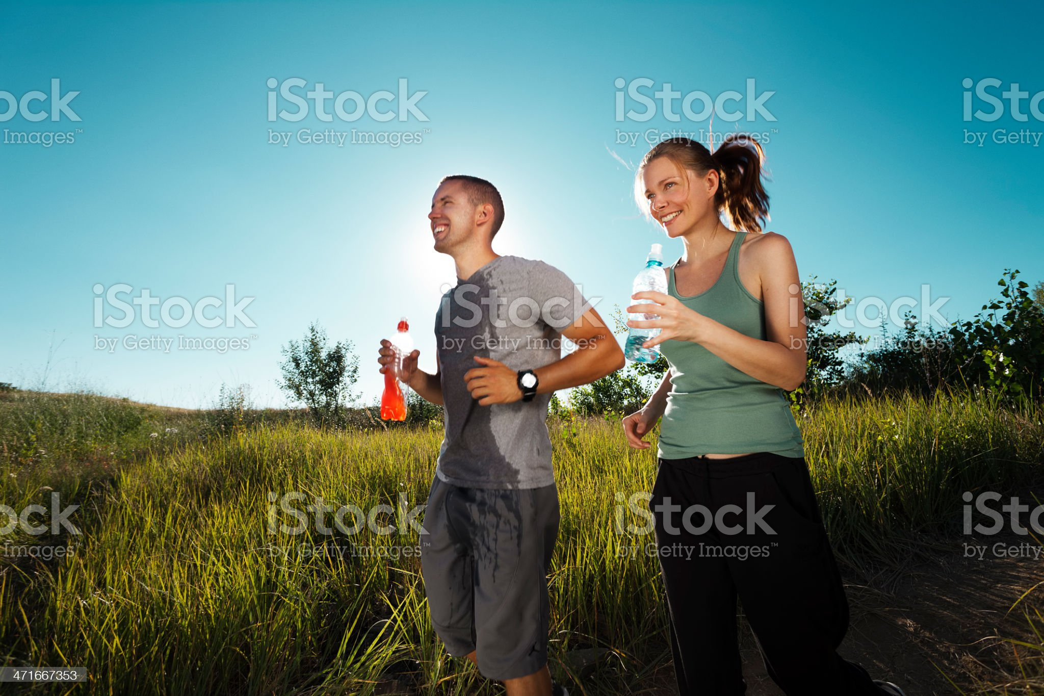 Young couple jogging in nature royalty-free stock photo