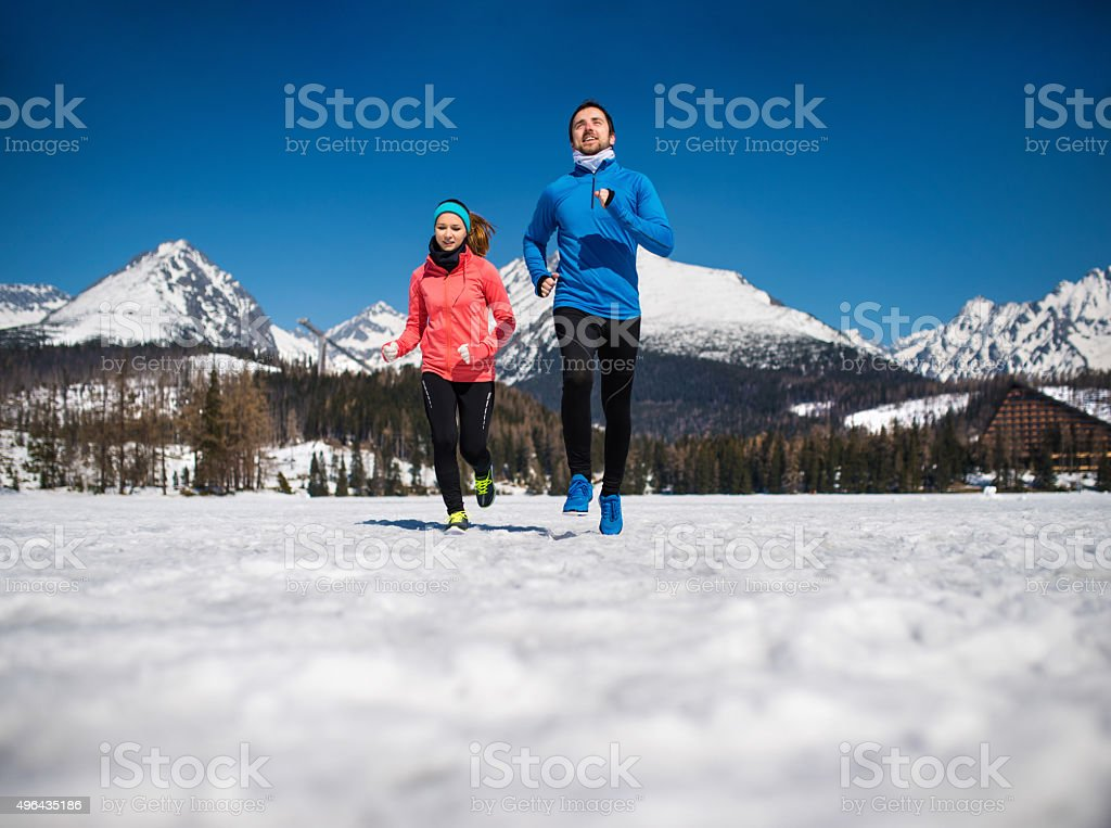 Young couple jogging stock photo