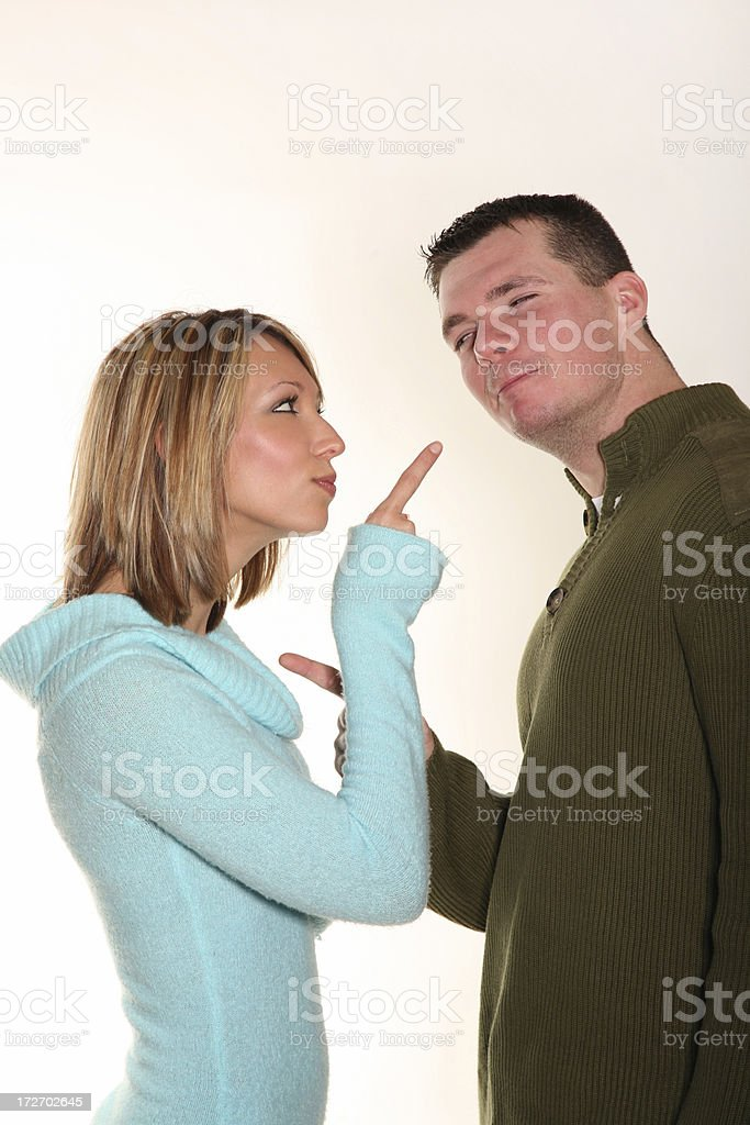 Young couple joking around disagreeing and pointing fingers stock photo