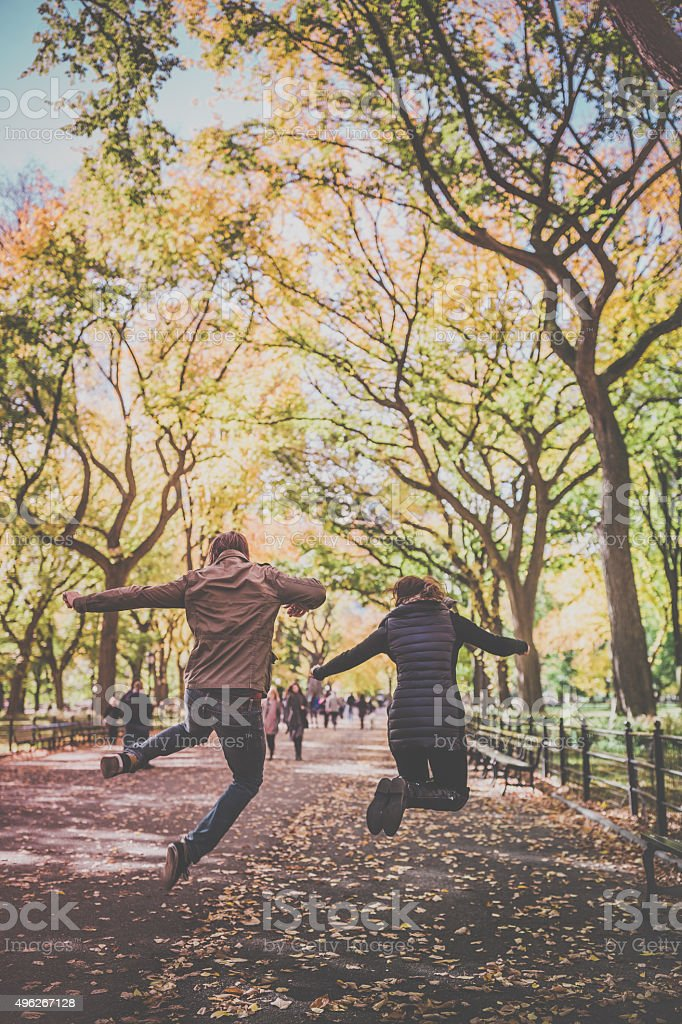 Young Couple Jumping in Central Park, NYC stock photo