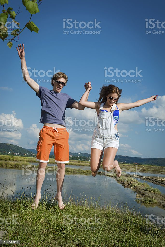 Young Couple Jumping, Summer Vacations, Mediteranean, Europe stock photo