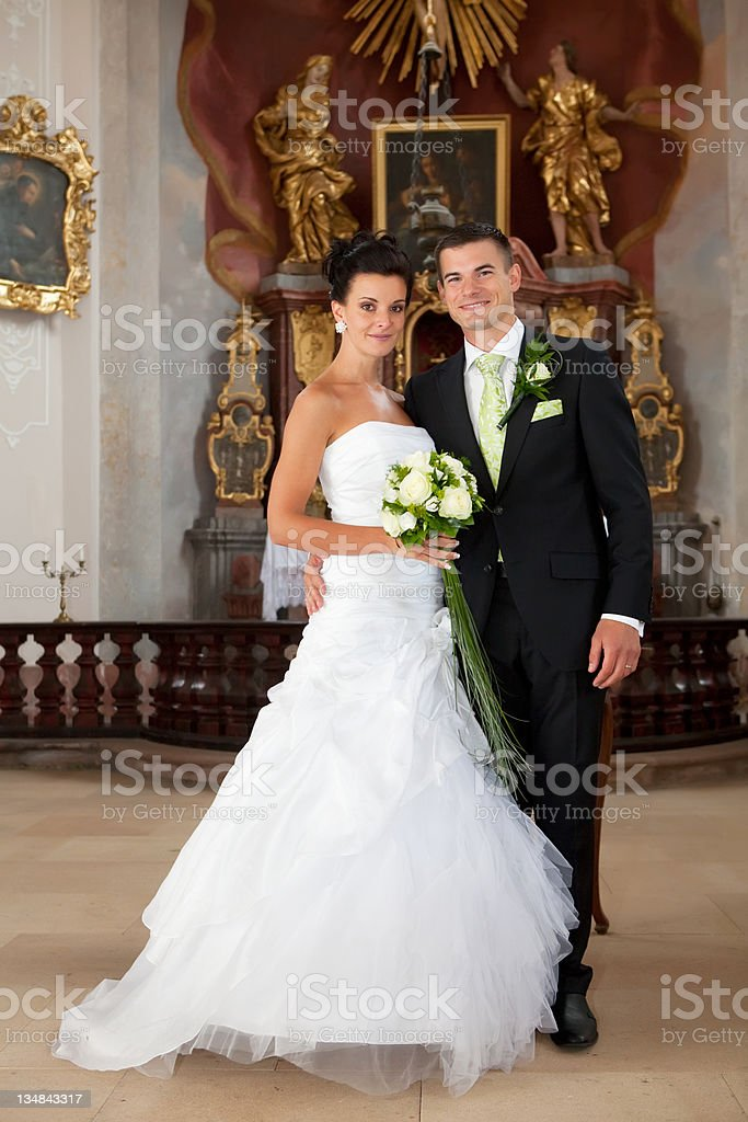 Young couple just married inside of church royalty-free stock photo