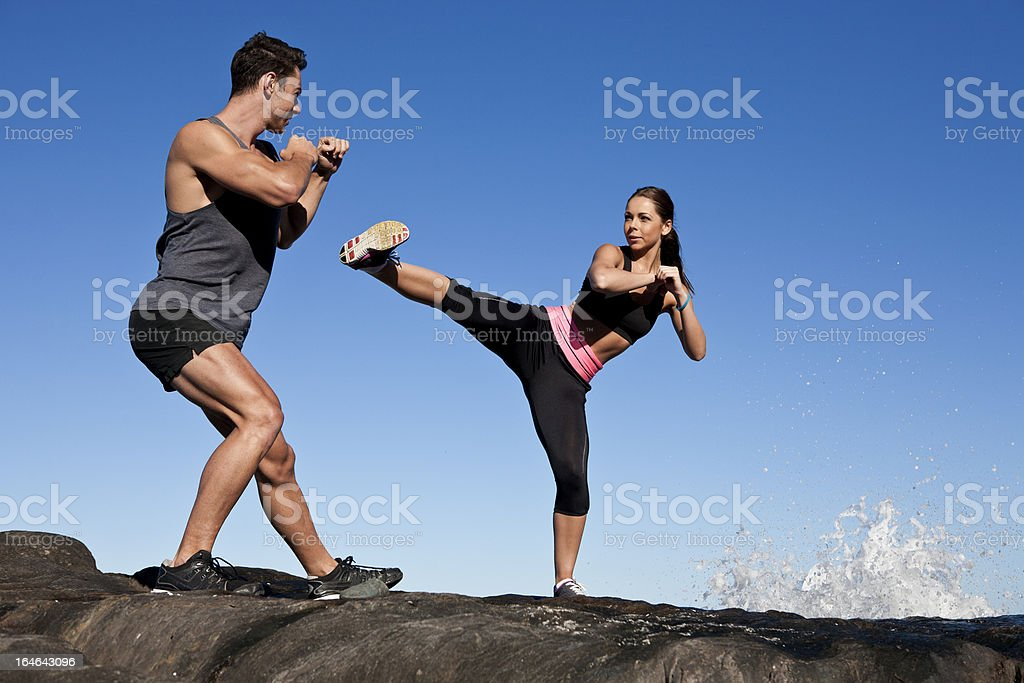 Young couple kickboxing royalty-free stock photo