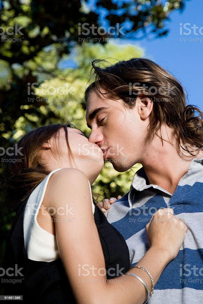 Young Couple Kiss stock photo