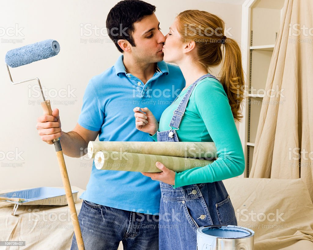 Young Couple Kissing and Painting royalty-free stock photo