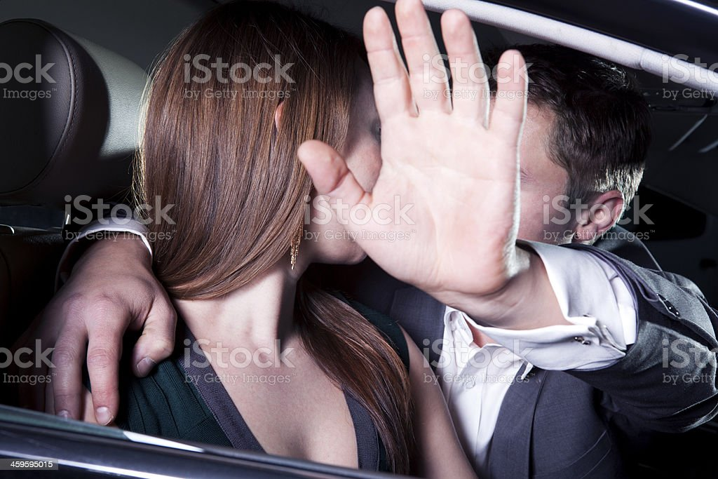 Young couple kissing in car at a red carpet event stock photo