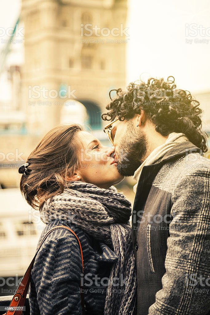 Young couple kissing in London stock photo