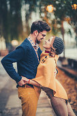 young couple kissing in the sunshine
