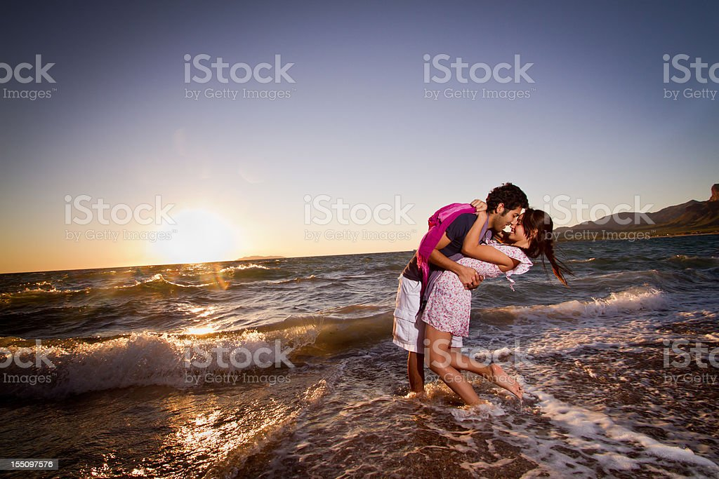 Young Couple Kissing in the Surf stock photo