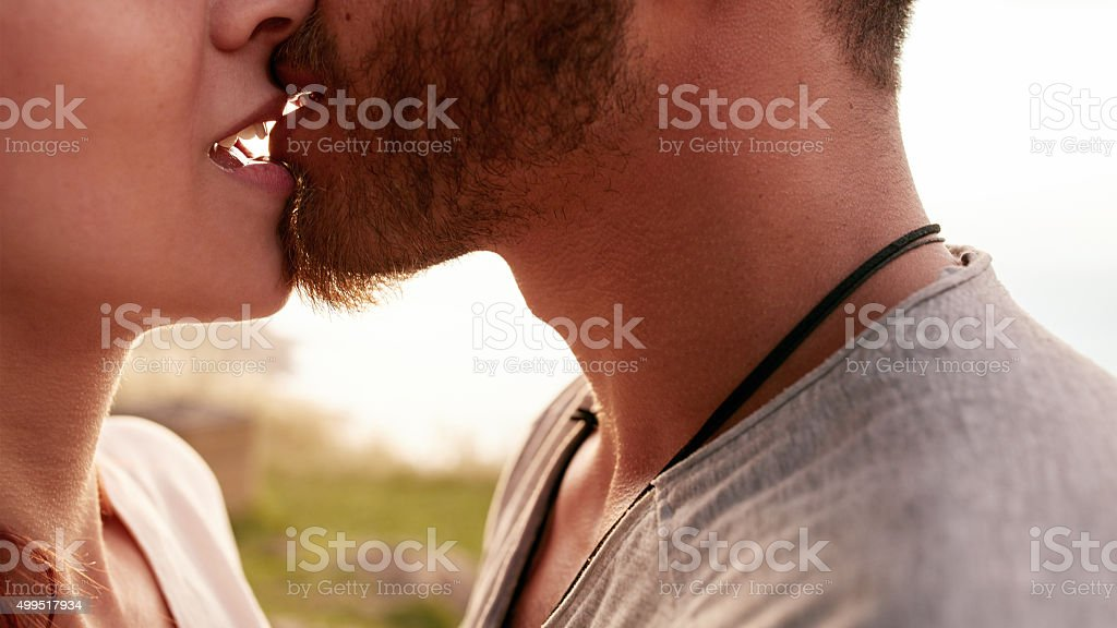 Young couple kissing passionately stock photo
