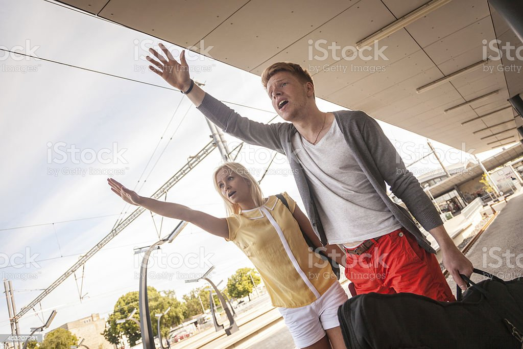Young Couple Late at Train Station royalty-free stock photo