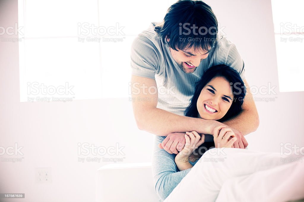 young couple laughing and bonding royalty-free stock photo