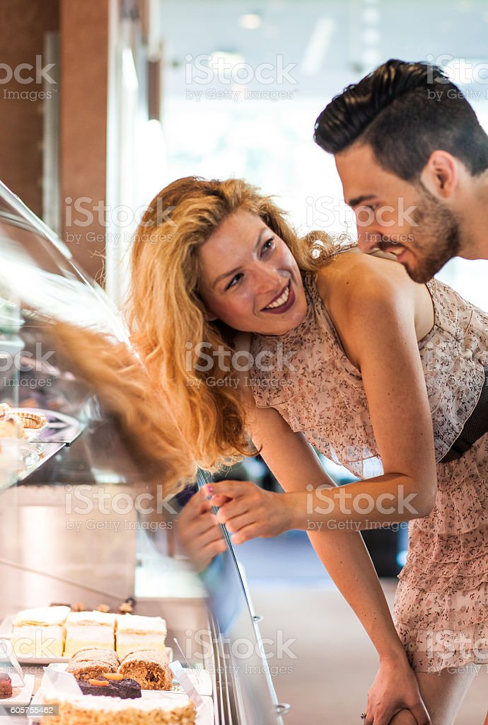 Young Couple Looking at Cakes in a Pastry Shop stock photo