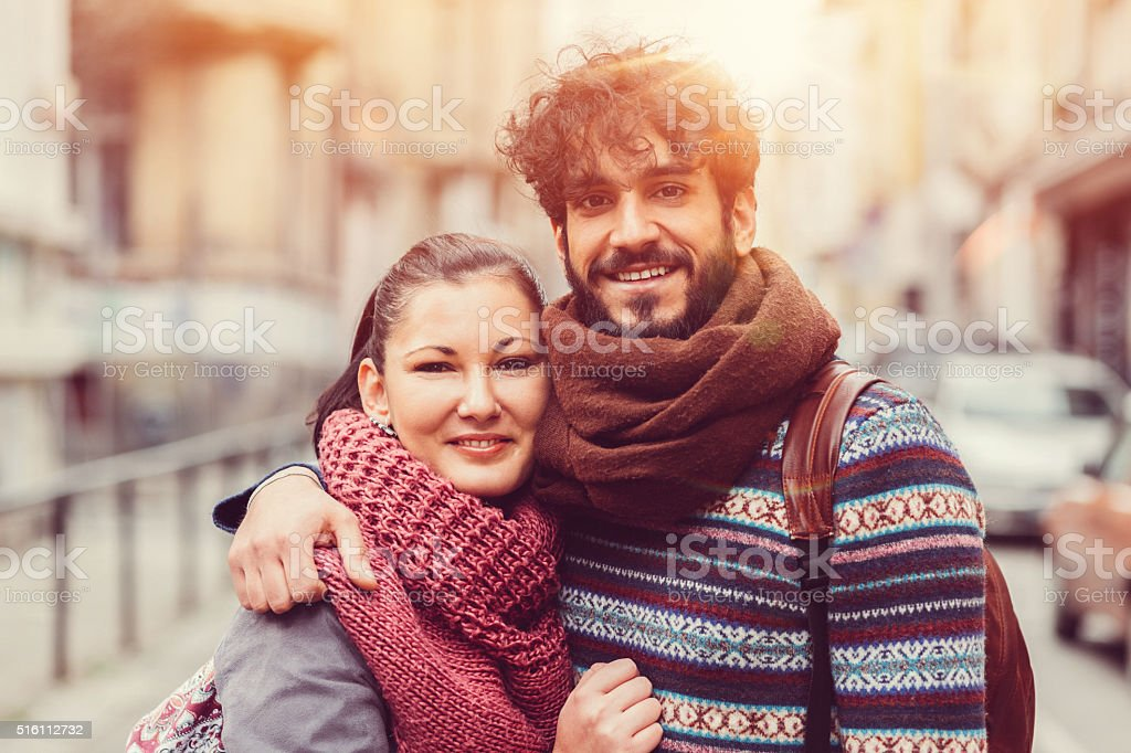 Young couple looking at camera stock photo