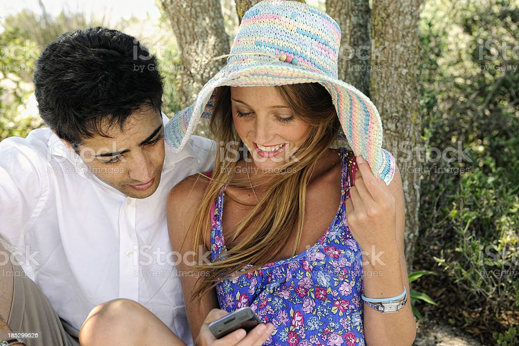 Young Couple Looking at Cell Phone stock photo