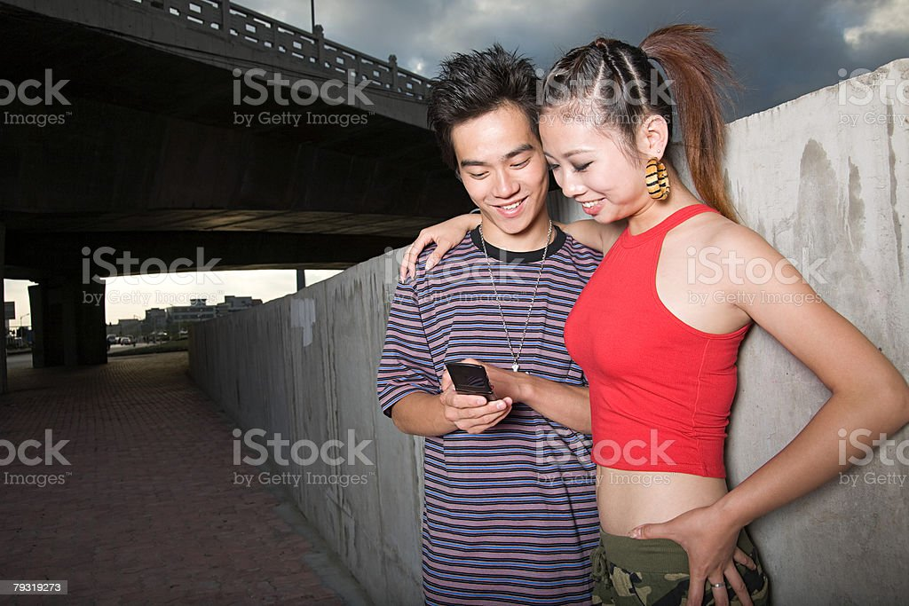 Young couple looking at cellphone royalty-free stock photo
