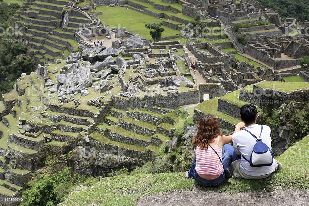 Young Couple Looking at Machu Picchu, Peru stock photo