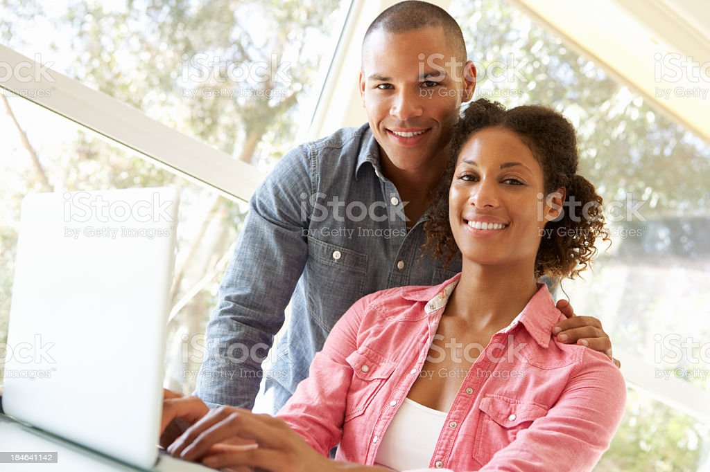 Young couple looking at something on a laptop royalty-free stock photo