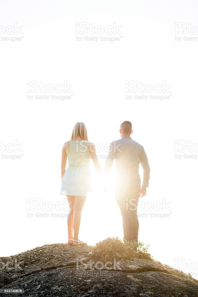 Young Couple Looking At The Sunset stock photo