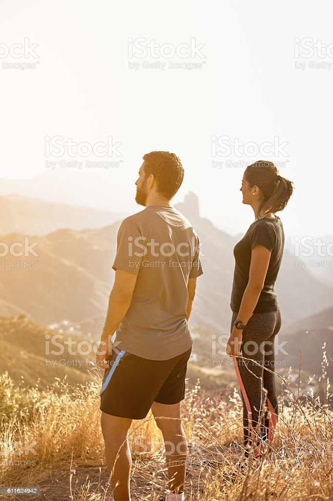 Young couple looking at the view stock photo