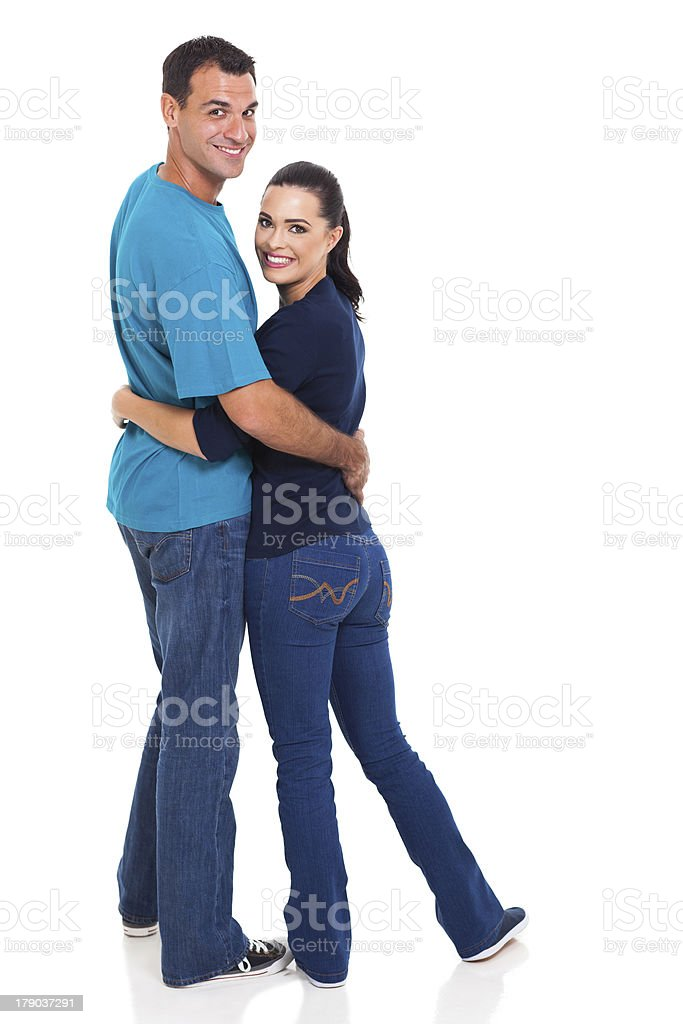 young couple looking back royalty-free stock photo