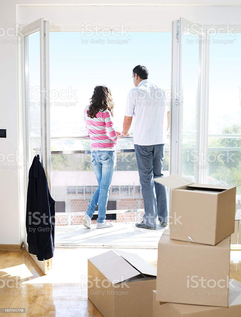 Young Couple Looking Over Balcony at City royalty-free stock photo