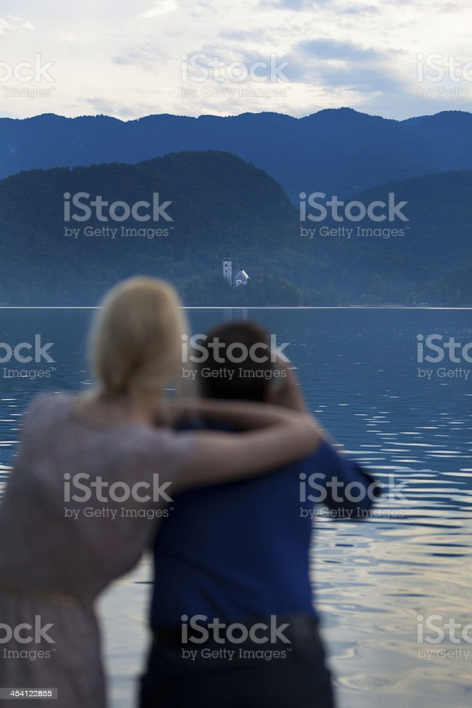 Young couple looking over lake Bled, Slovenia stock photo