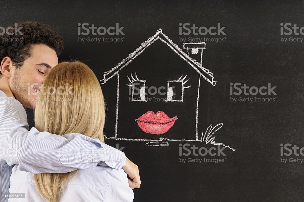 Young Couple Looking Sketched Model Home royalty-free stock photo