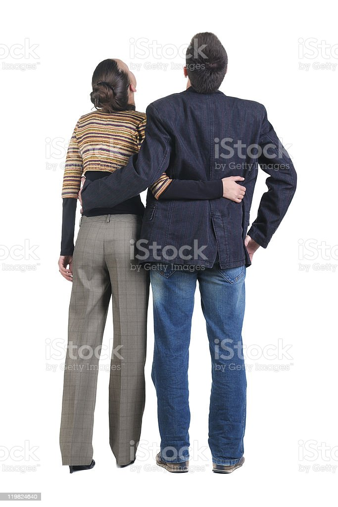 Young couple looks where that. Rear view royalty-free stock photo