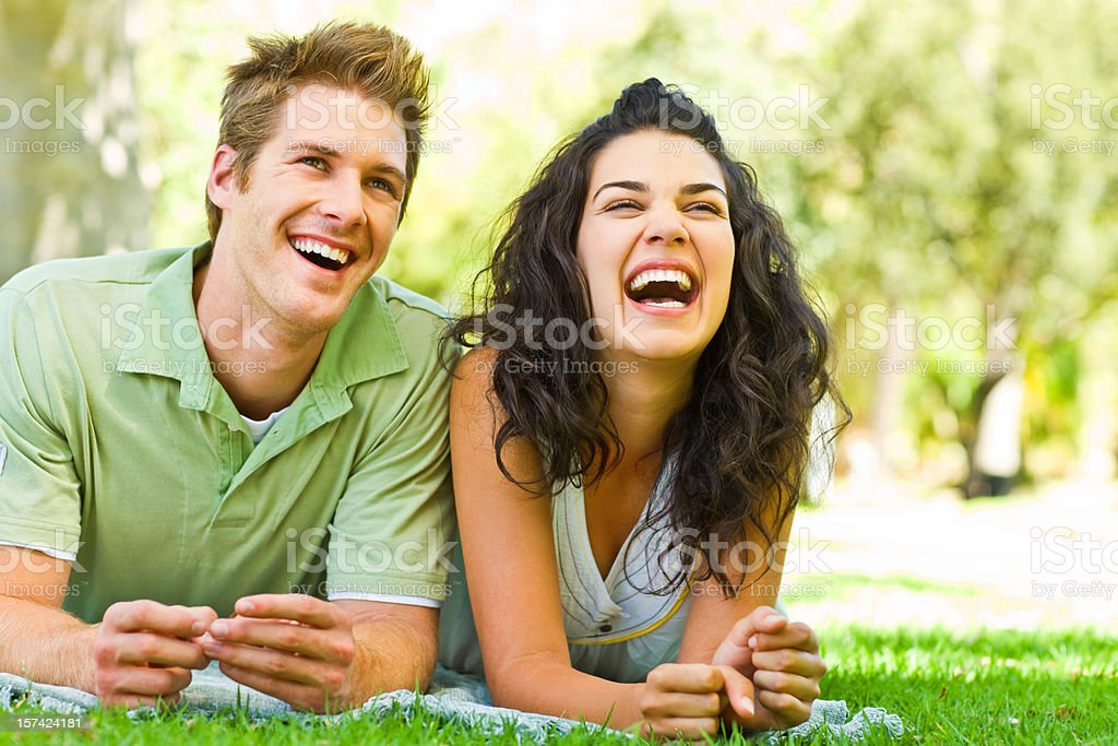 Young couple lying and enjoying at park royalty-free stock photo